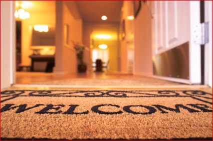 Entrance to a house with welcome mat
